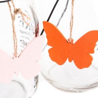 Üveg gyertyatartó pillangóval